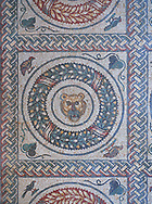Close up picture of the Roman mosaics of the Peristyle depicting animals in a geometric mosaic wreath inside square panels, room no 13 at the Villa Romana del Casale, first quarter of the 4th century AD. Sicily, Italy. A UNESCO World Heritage Site.<br /> <br /> The peristyle mosaic floor of Villa Romana del Casale is decorated with square mosaic repeating designs which have a rope design geometric mosaic on the outside, inside which is are laurel wreath mosaics which surround Protomas, the representation of the head and neck of an animal often used decoratively in architecture, of wild and domesticated animals. The two sides of the peristyle have been identified as one side for visitors use and the other for the family. The peristyle mosaics lead on both sides around three sides of the peristyle to steps that lead up to the corridor of the Great Hunt Mosaics, .<br /> <br /> If you prefer to buy from our ALAMY PHOTO LIBRARY  Collection visit : https://www.alamy.com/portfolio/paul-williams-funkystock/villaromanadelcasale.html<br /> Visit our ROMAN MOSAICS PHOTO COLLECTIONS for more photos to buy as buy as wall art prints https://funkystock.photoshelter.com/gallery/Roman-Mosaics-Roman-Mosaic-Pictures-Photos-and-Images-Fotos/G00008dLtP71H_yc/C0000q_tZnliJD08