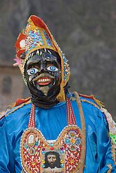 Masked dancer at Pentecostes Festival held annually in May, Ollantaytambo, Peru, South America