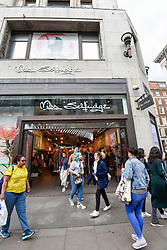 © Licensed to London News Pictures. 28/05/2019. LONDON, UK.  Shoppers pass by outside the flagship Miss Selfridge store on Oxford Circus.  Sir Philip Green's Arcadia Group is to close the store in July 2019 and move it to a concession in the adjacent Topshop.  Arcadia Group, which also includes Topshop, Wallis, Dorothy Perkins, Evans and Burton, will seek approval from creditors for a company voluntary arrangement (CVA), enabling store closures and rent cuts..  Photo credit: Stephen Chung/LNP