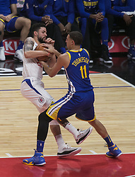 October 30, 2017 - Los Angeles, California, U.S - Austin Rivers #25 of the Los Angeles Clippers battles for the ball with Klay Thompson #11 of the Golden State Warriors  during their NBA game on Monday October 30, 2017 at the Staples Center in Los Angeles, California. Clippers lose to Warriors, 141-113. (Credit Image: © Prensa Internacional via ZUMA Wire)