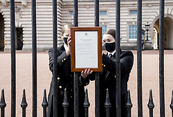 A sign announcing the death of the Duke of Edinburgh, who has died at the age of 99, is placed on the gates of Buckingham Palace, London. Picture date: Friday April 9, 2021.