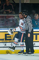 KELOWNA, CANADA - SEPTEMBER 22:  Zane Franklin #16 of the Kamloops Blazers is escorted to the penalty box by a linesman after fighting against the Kelowna Rockets on September 22, 2018 at Prospera Place in Kelowna, British Columbia, Canada.  (Photo by Marissa Baecker/Shoot the Breeze)  *** Local Caption ***