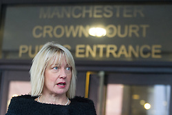 © Licensed to London News Pictures . 08/02/2013 . Manchester , UK . CLAIRE MORELAND , current head of Chethams School of Music in Manchester reads a prepared statement outside Manchester Crown Court today (8th February 2013) , after former choirmaster Michael Brewer and his ex wife Hilary Brewer were convicted of historic sexual assaults against pupils . Today it was revealed that witness Frances Andrade died in a suspected suicide , after giving evidence at the trial . Photo credit : Joel Goodman/LNP