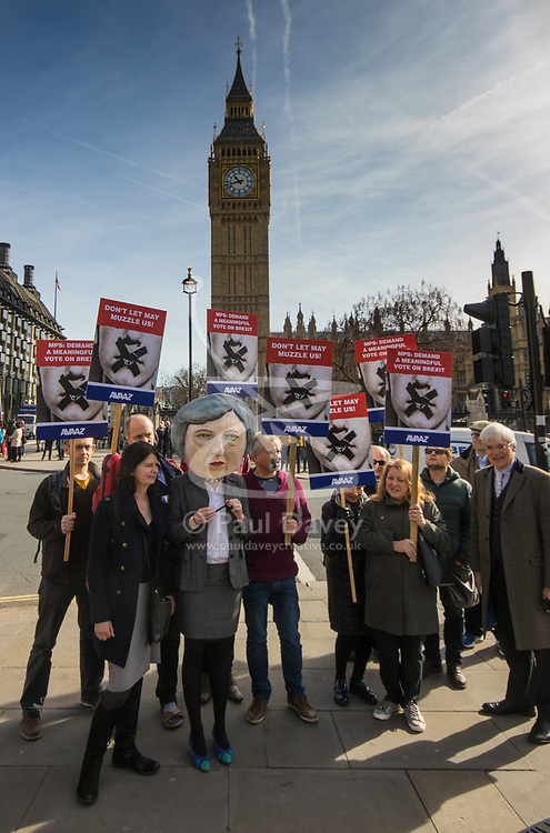 """Westminster, London, March 13th 2017. An effigy of Theresa May and protesters with their mouths taped shut demonstrate outside Parliament against what they claim is a gag by British Prime Minister Theresa May """"whipping MPs to endorse a 'blank cheque Brexit', as MPs vote on the Lords amendment of Article 50."""""""