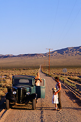 1930's scene of a family on a dirt road, route 66 in California