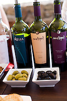 Bottles of wine and snacks are part of the tasting experience at Bodega Melipal in the Luján de Cuyo area of Mendoza, Argentina.