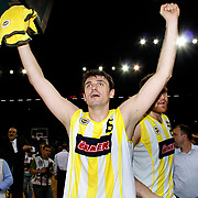 Fenerbahce Ulker's Mirsad TURKCAN celebrate victory during their Turkish Basketball league Play Off Final Sixth Leg match Fenerbahce Ulker between Efes Pilsen at the Abdi Ipekci Arena in Istanbul Turkey on Wednesday 02 June 2010. Photo by TURKPIX
