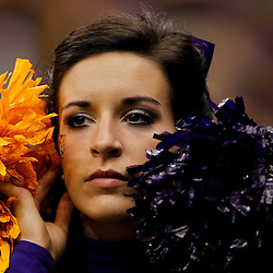 Jan 9, 2012; New Orleans, LA, USA; A LSU Tigers cheerleader looks on during the second half of the 2012 BCS National Championship game against the Alabama Crimson Tide at the Mercedes-Benz Superdome.  Mandatory Credit: Derick E. Hingle-US PRESSWIRE