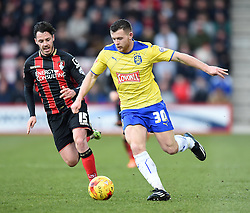 Bournemouth's Adam Smith closes in on Huddersfield Town's Harry Bunn  - Photo mandatory by-line: Paul Knight/JMP - Mobile: 07966 386802 - 14/02/2015 - SPORT - Football - Bournemouth - Goldsands Stadium - AFC Bournemouth v Huddersfield Town - Sky Bet Championship