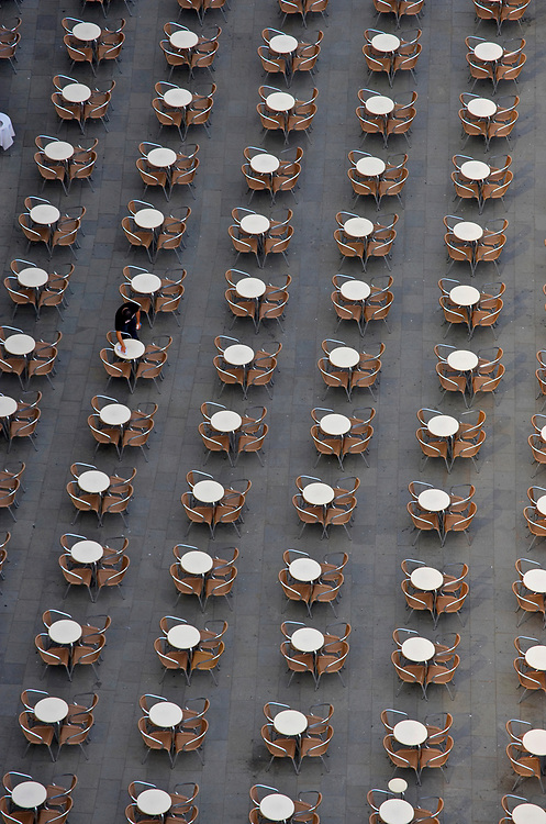 Tables at an outdoor cafe in the  Piazza San Marco, Venice, Italy