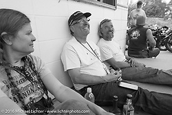 Cris Sommer Simmons takes a break with Buzz Kanter and Paul Ousey at a fuel stop during Stage 13 (257 miles) of the Motorcycle Cannonball Cross-Country Endurance Run, which on this day ran from Elko, NV to Meridian, Idaho, USA. Thursday, September 18, 2014.  Photography ©2014 Michael Lichter.