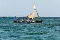 Kuna Indians in dugout canoe sailboat near  Crab Island (Carti Sugdup), San Blas Islands (Kuna Yala), Caribbean Sea, Panama