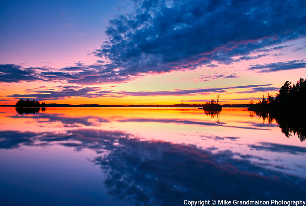 Clouds reflected in Lac-aux-Sables at sunset<br />Belleterre<br />Quebec<br />Canada