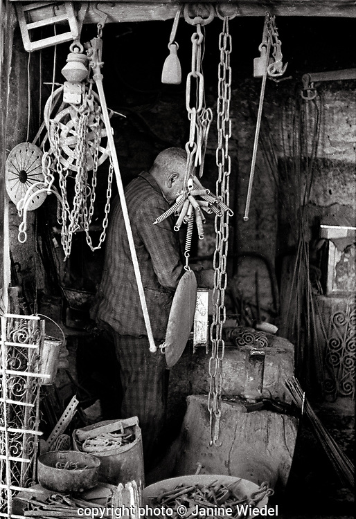 Craftsmen working in small workshops in the Tehran Bazaar Iran 1970s