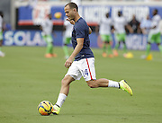JACKSONVILLE, FL - JUNE 07:  Midfielder Brad Davis #14 of the United States warms up before the international friendly match against Nigeria at EverBank Field on June 7, 2014 in Jacksonville, Florida.  (Photo by Mike Zarrilli/Getty Images)