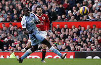 Photo: Paul Thomas.<br /> Manchester United v Manchester City. The Barclays Premiership. 09/12/2006.<br /> <br /> Ryan Giggs (R) of Man Utd shoots past Micah Richards of Man City.