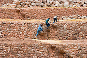 Boys climb up stairs inside the Inca agricultural terraces of Moray, Urubamba Valley, Peru on September 22, 2005. The site is believed to have been used for experimental agriculture, self irrigating and recessed for artificially warmer and wetter conditions.
