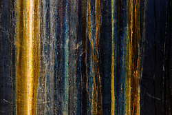Stained metal abstract of water tank, Ladder Ranch, west of Truth or Consequences, New Mexico, USA.