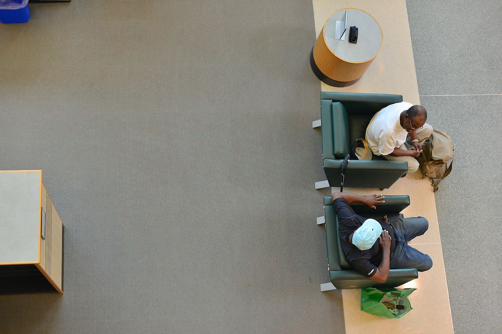 Overhead view of two men conversing at the Akron-Summit County Public Library.