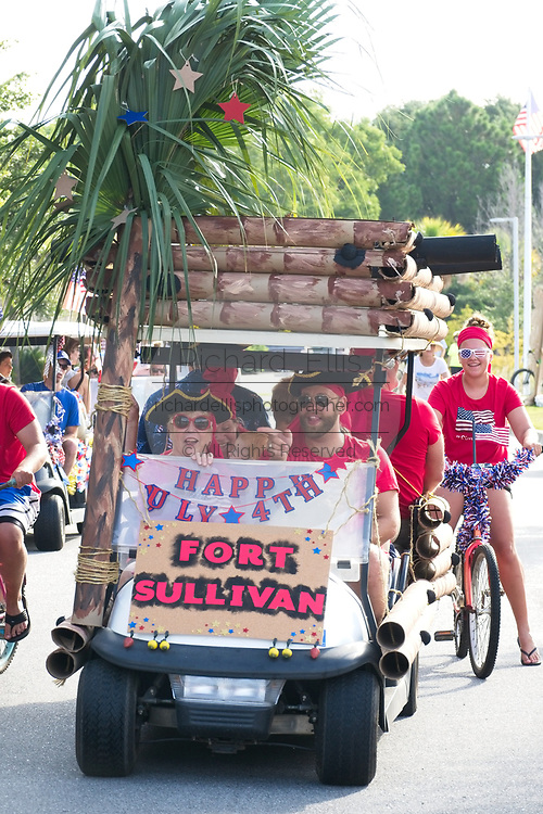 A group dressed as pirates rides along in a golf cart decorated as Fort Sullivan during the annual Sullivan's Island Independence Day parade July 4, 2017 in Sullivan's Island, South Carolina. The tiny affluent sea island was once the home of pirates and later military forts that were instrumental in both the Revolutionary and Civil Wars.
