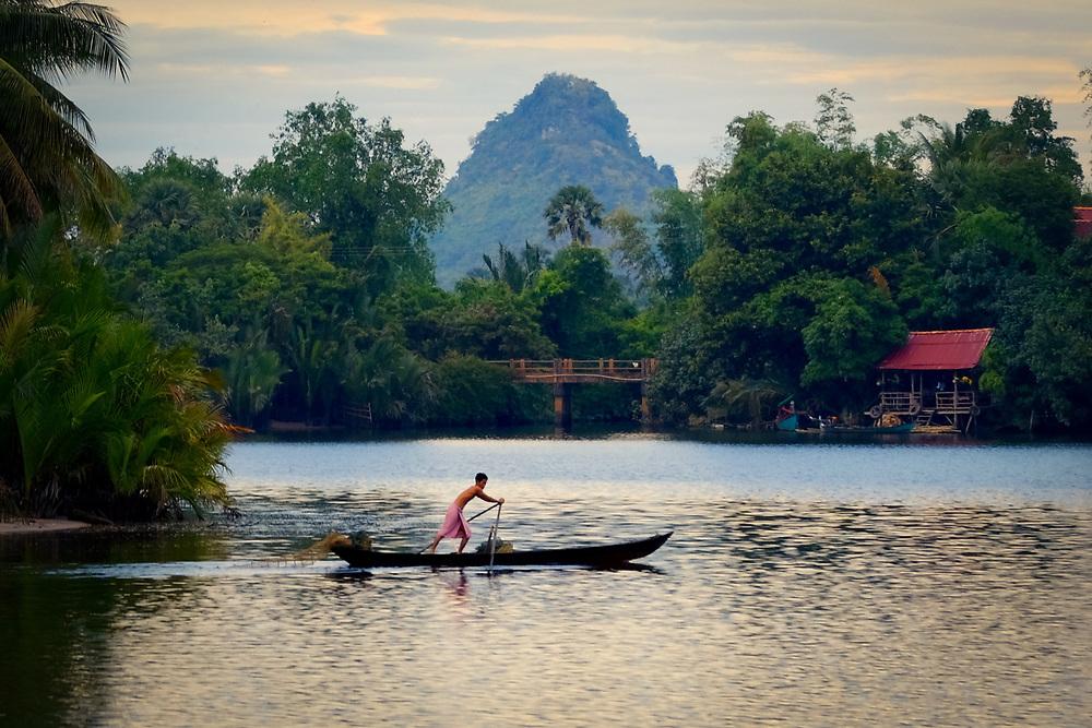 Fisherman on Kampot River. Cambodia. <br /> Photo by Lorenz Berna