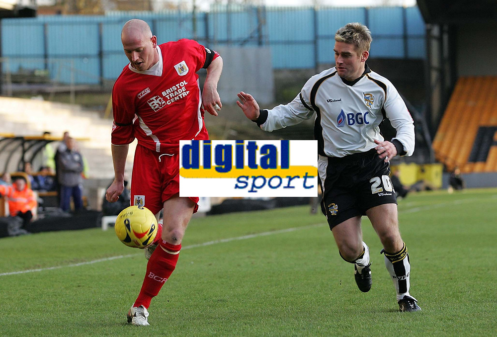 Photo: Paul Thomas.<br /> Port Vale v Bristol City. Coca Cola League 1. 17/12/2005.<br /> <br /> Bristol's Steve Brooker keeps the the away from Mickey Bell.