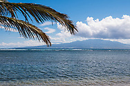 A view of Maui island from a beach on Molokai, Hawaii