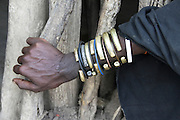 Africa, Tanzania, female member of the Datoga tribe. Close-up of the traditional armbands and bracelets