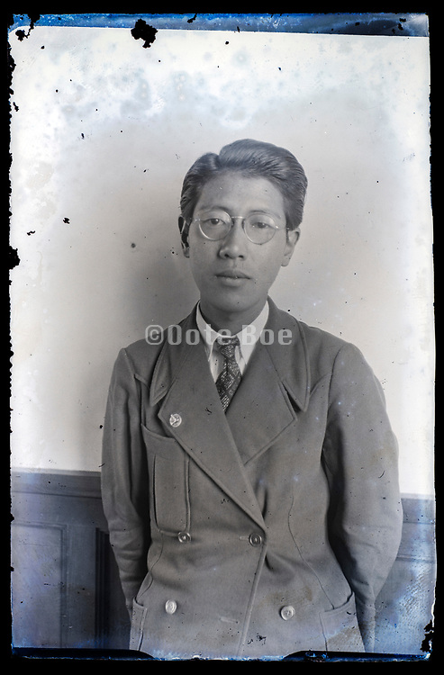 deteriorating portrait of a young adult man Japan ca 1930s