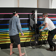 Artist Benedict Radcliffe creating his piece using a customised bike carrying a number of spary cans assisted by Louis Gibson for the Free Ride Art Space show. Two shows at once, Les Fleurs du Mal - New Art from London curated by Cedar Lewisohn and Free Ride Art Space / bicycle exhibition curated by Blandine Roselle. The shows run 30 April - 17 June.