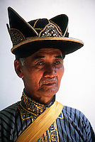 Man in traditional dress seen at the Royal Palace in Yogjakarta, Indonesia. Photograph by Jayne Fincher