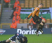 Photo: Dave Linney.<br />Wolverhampton Wanderers v Plymouth Argyle. The FA Cu Plymouth's .Romain Larrieu(L)  collects the ball before  Kenny Miller can take advantage.<br />07/01/2006.