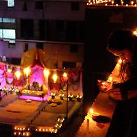Priya Sharan lights candles as the children and adults at Sri Ram Ashram near Haridwar, India prepare to celebrate Diwali.<br /> November 2018<br /> Photo by Shmuel Thaler <br /> shmuel_thaler@yahoo.com www.shmuelthaler.com