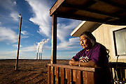 Betty Thompson stands on her porch at her home in Page, Ariz. near the Navajo Generating Station. Thompson's late mother, Sally Young, resisted the station before it was built in the 1970s, which now looms over her backyard. (For National Parks Conservation Association)