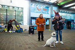 © Licensed to London News Pictures. 25/12/2020. Manchester, UK. Homeless couple NATHAN DALE (25) and AMY DEWHURST (26) and their dog APACHE , on Market Street in Manchester City Centre on Christmas Day . Photo credit: Joel Goodman/LNP
