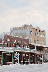 """""""Snowy Sierra Tavern 2"""" - This snow scene of the Sierra Tavern and Commercial Row was photographed in historic Downtown Truckee, CA."""