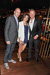 Left to right, JONNY LEE MILLER and GARY & LAUREN KEMP at a dinner to celebrate the beginning of a unique partnership between The Naked Heart Foundation and W's Newest Hotel W St.Petersburg -The 'For Russia With Love' dinner was hosted by Sadie Frost and Natalia Vodianova at Spice Market restaurant, W London, Leicester Square, London on 2nd June 2011.