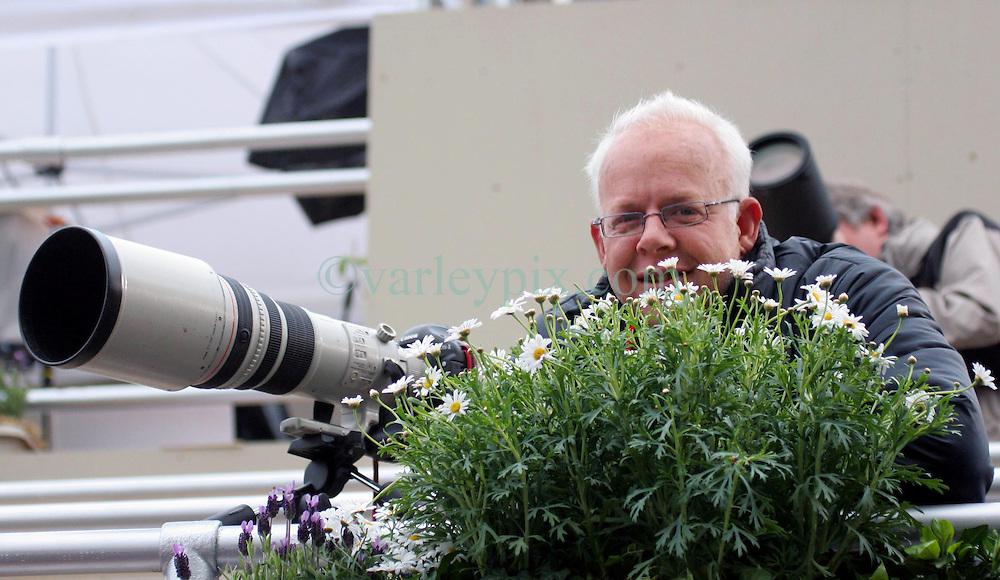 29 April 2011. London, England..Royal wedding day. Ever the consummate pro at hiding behind a bush! Sun photographer Mark Giddings hard at work. Westminster Abbey. .Photo; Charlie Varley.