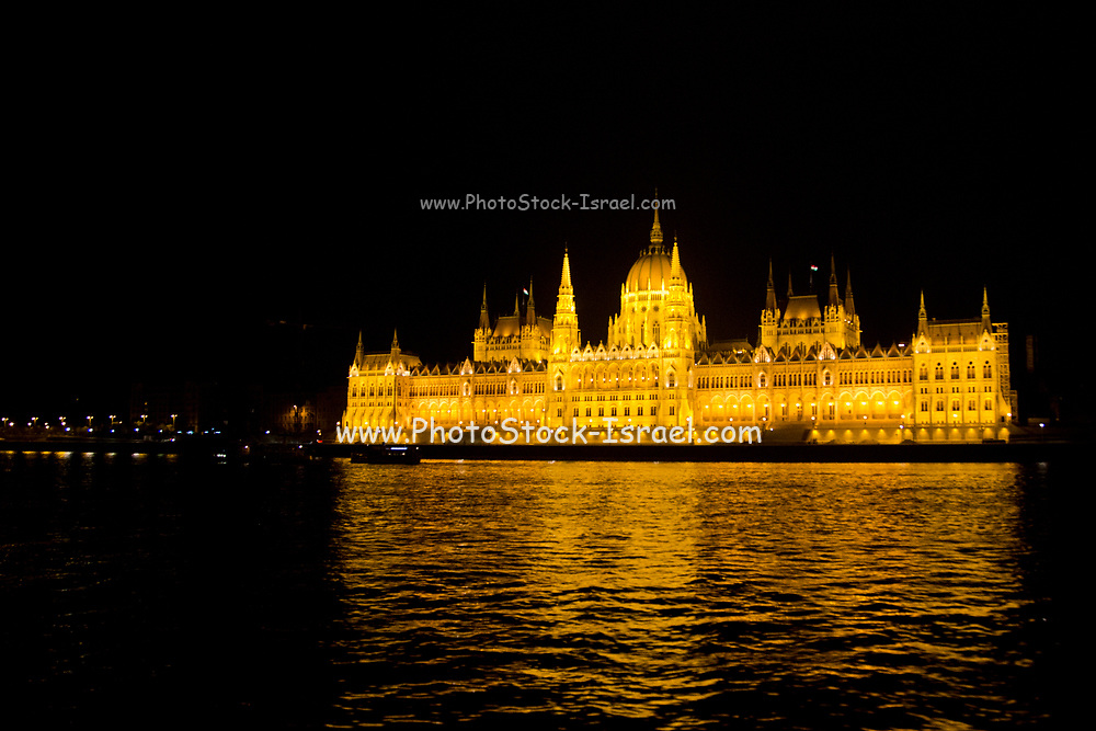 Hungarian Parliament at night. Budapest, Hungary, The Danube River in the foreground