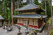 """Toshogu Shrine is the final resting place of Tokugawa Ieyasu, the founder of the Tokugawa Shogunate that ruled Japan for over 250 years until 1868. Ieyasu is enshrined at Toshogu as the deity Tosho Daigongen, """"Great Deity of the East Shining Light"""". Initially a relatively simple mausoleum, Toshogu was enlarged into the spectacular complex seen today by Ieyasu's grandson Iemitsu during the first half of the 1600s. The lavishly decorated shrine complex consists of more than a dozen buildings set in a beautiful forest. Countless wood carvings and large amounts of gold leaf were used to decorate the buildings in a way not seen elsewhere in Japan. Toshogu contains both Shinto and Buddhist elements, as was common until the Meiji Period when Shinto was deliberately separated from Buddhism. Toshogu is part of Shrines and Temples of Nikko UNESCO World Heritage site."""