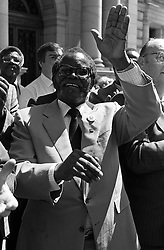 Oliver Tambo. President of the African National Congress waves to Scottish supporters during a 'Free Nelson Mandela' rally outside the City Chambers.