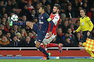 Thiago Silva of Paris Saint-Germain is challenged by Olivier Giroud of Arsenal. UEFA Champions league group A match, Arsenal v Paris Saint Germain at the Emirates Stadium in London on Wednesday 23rd November 2016.<br /> pic by John Patrick Fletcher, Andrew Orchard sports photography.