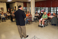 Congressman Frank Guinta answers a question from Matt Tetreault during his visit to the Laconia Housing Authority Sunrise Towers on Thursday afternoon.  (Karen Bobotas/for the Laconia Daily Sun)