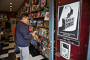 Patrons fill the store during Free Comic Book Day at Black Cat Comics in Milpitas, California, on May 6, 2017. (Stan Olszewski/SOSKIphoto)