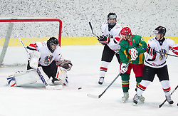 Goalkeeper of Austria Andreas Brenkusch, Berhard Fechtig of Austria, Laisvydas Rimkus of Lithuania,  Mathias Grabner of Austria during the ice hockey match between National teams of Lithuania (LTU) and Austria (AUT) at 2011 IIHF World U20 Championship Division I - Group B, on December 12, 2010 in Ice skating Arena, Bled, Slovenia.  (Photo By Vid Ponikvar / Sportida.com)