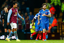Kieran Richardson of Aston Villa looks dejected as goalscorer Romain Vincelot of Leyton Orient runs past after giving his side a 0-1 lead - Photo mandatory by-line: Rogan Thomson/JMP - 07966 386802 - 27/08/2014 - SPORT - FOOTBALL - Villa Park, Birmingham - Aston Villa v Leyton Orient - Capital One Cup Round 2.