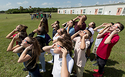 August 21, 2017 - Boynton Beach, Florida, U.S. - Seventh graders in Sam Mazzetesta's civics class watch the partial eclipse at Christa McAuliffe Middle School. The school purchased special glasses for all of its students to watch the event for a few minutes in Boynton Beach, Florida on August 21, 2017. (Credit Image: © Allen Eyestone/The Palm Beach Post via ZUMA Wire)