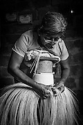 """2015/03/13 - Pile, Ecuador: Mariana Rivera, 73, weaves a """"Montecristi hat"""" in her house early in the morning. She started to weave hats at the age of 10. Nowadays she doesn't weave the finest hats as before because her eyes are tired and old as she says. So, Mariana uses thicker straw to weave a hat, which brings the price down. She sells them at around US$200, but sometimes even less if she is really desperate for money.  UNESCO declared the """"Montecristi hat"""" in 2012 as Intangible Cultural Heritage of Humanity."""