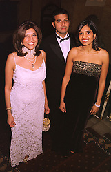 Left to right, MRS VIMLA LALVANI, her former husband was a close friend of Diana, Princess of Wales, and her children MR DINO LALVANI and MISS DIVIA LALVANI, at a party in London on 30th January 1999.MNP 59