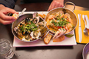 Spice Restaurant in Florence Oregon prepares fusion dishes with northwest ingredients like this Shellfish Madness in a lemongrass broth.